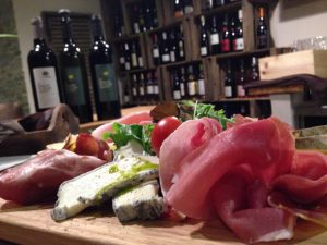 tasting cheese and procsiutto with local wines